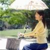 傘さしながら自転車乗る方法ない?